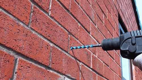 How to drill a hole in brick